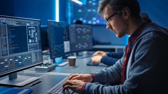 Man working behind computer